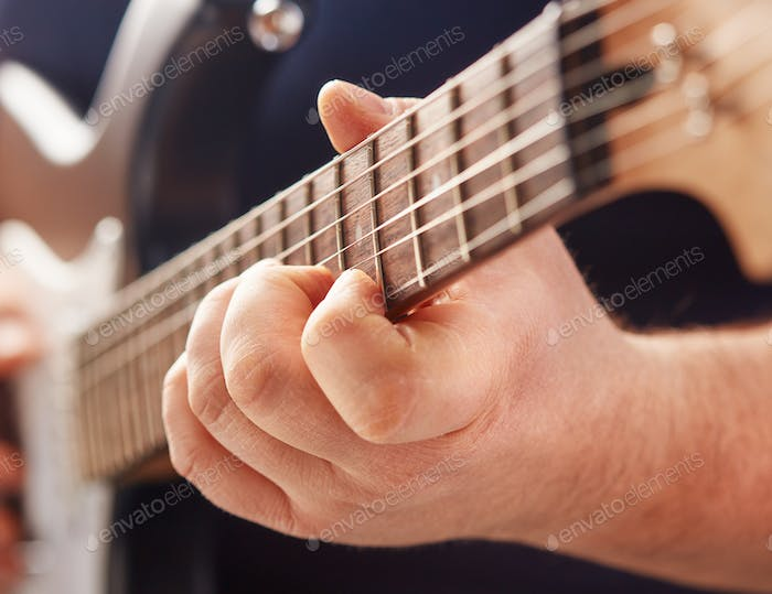 playing on electric guitar