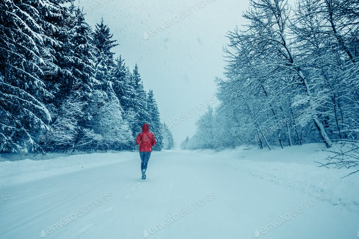 Woman Running Alone with Motion Blur during Cold Snowy day of Wi