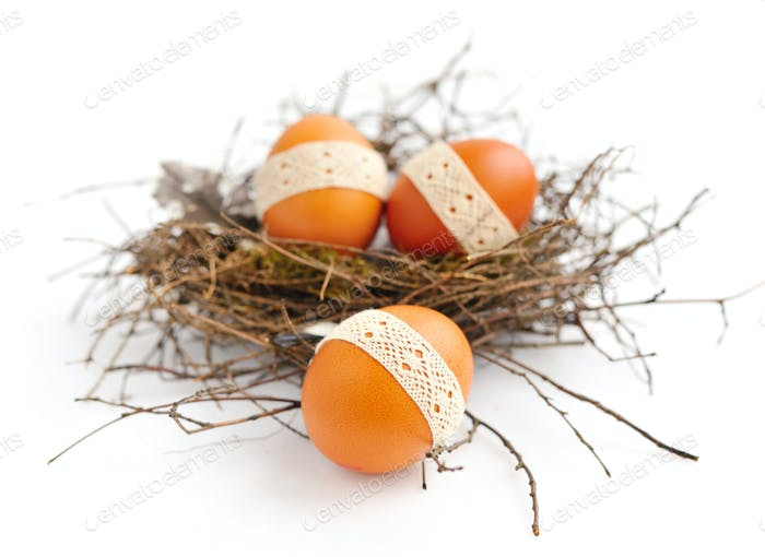 Nest with easter eggs on a white background