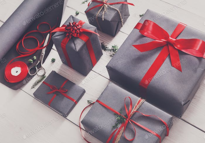 Gift wrapping. Packaging modern christmas present in boxes