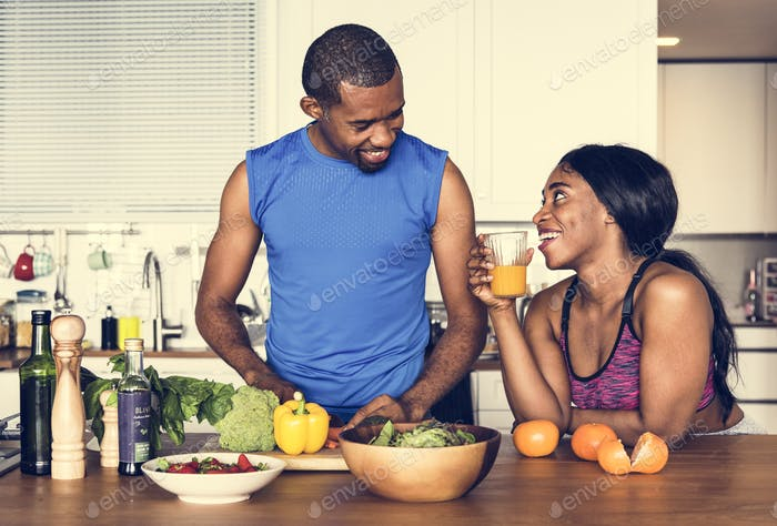 Thumbnail for Black couple cooking healthy food in the kitchen