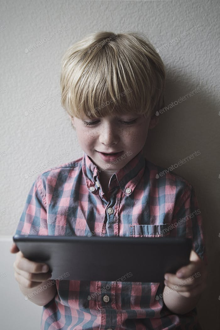 Little Boy on Tablet