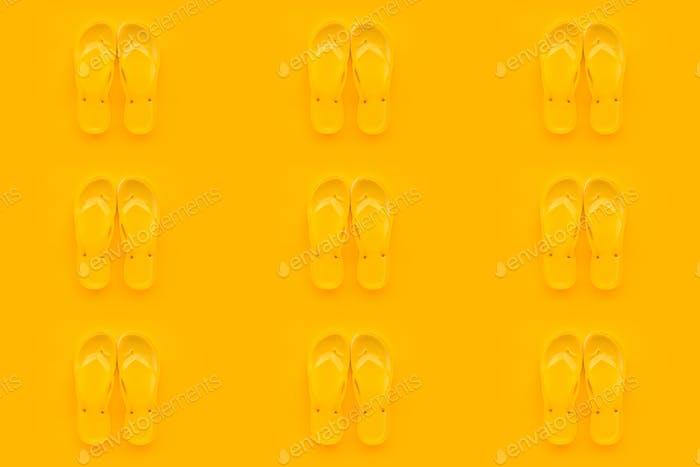 Seamless pattern background of yellow flip flops