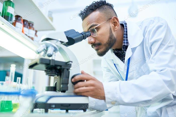 Scientist Using Microscope in Laboratory