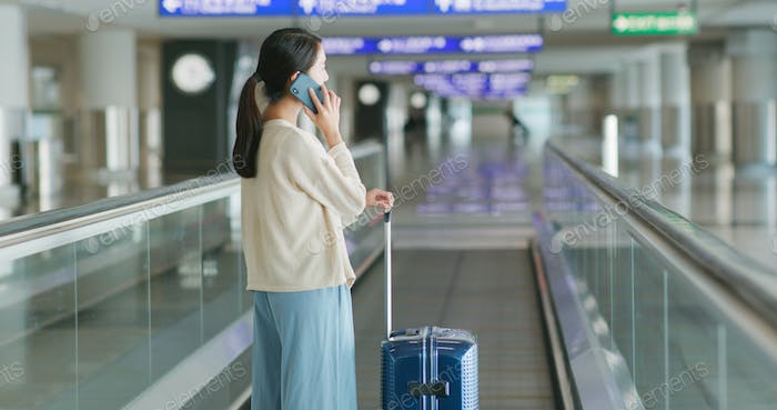 Woman talk to cellphone in airport