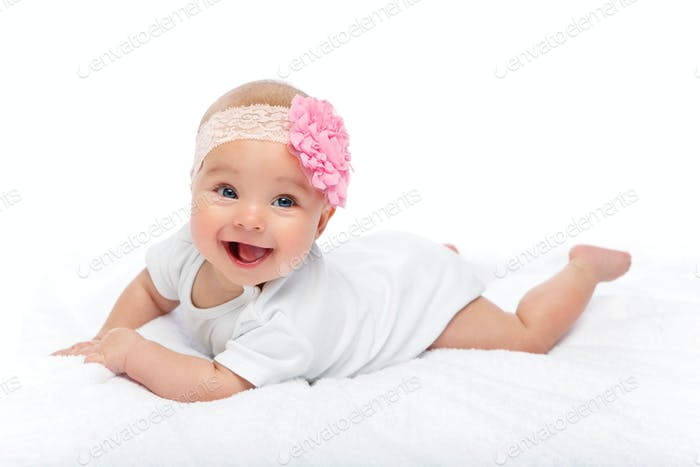 happy beautiful baby girl in white body suit