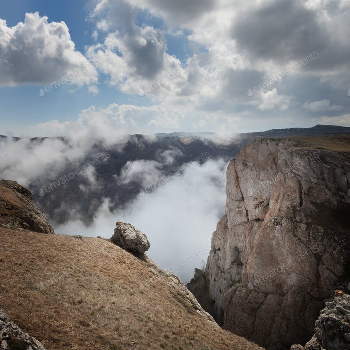Landscape. The mountains tower over the clouds