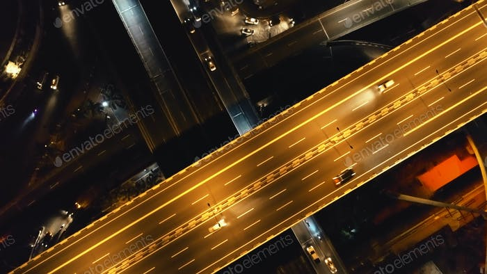 Closeup aerial top down: cars ride at night traffic road. Philippines cityscape, vehicles at highway