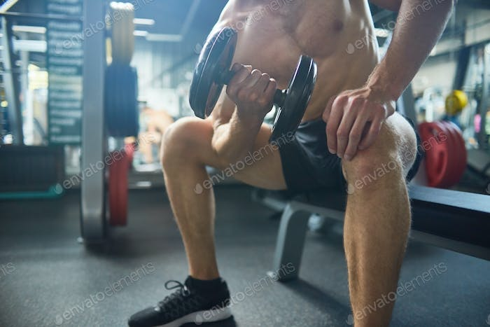 Flexing Muscles with Dumbbells