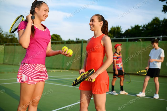 Mixed doubles tennis, happy players after game