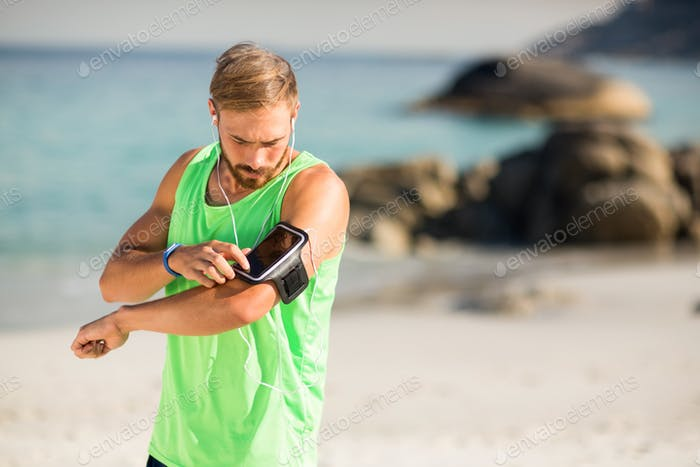 Man using phone at beach