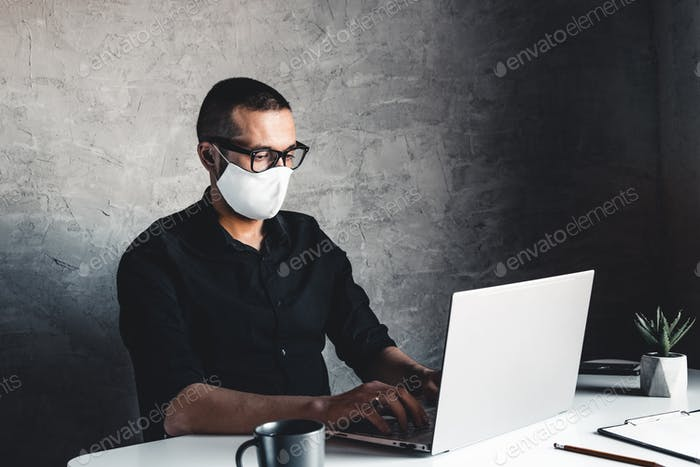 A man works or study during quarantine at the computer. Pandemic epidemic