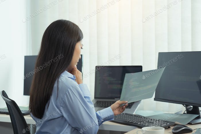 Asian woman was stressed in the early morning while contemplating the programs