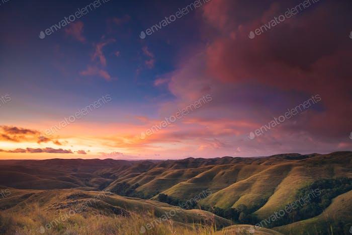 Colorful sunset sky over mountain panorama