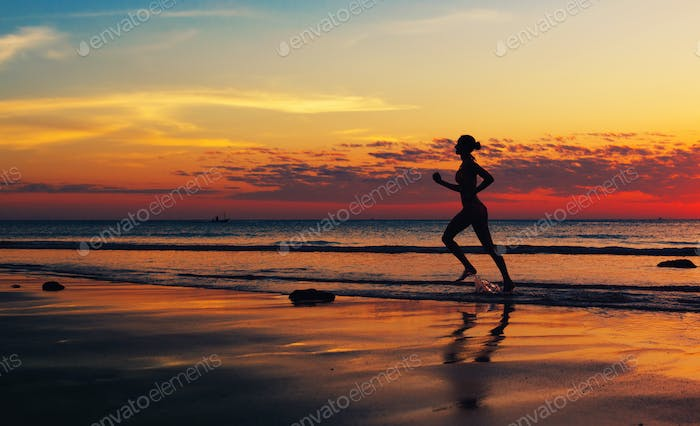 Woman runing  along the sea coast