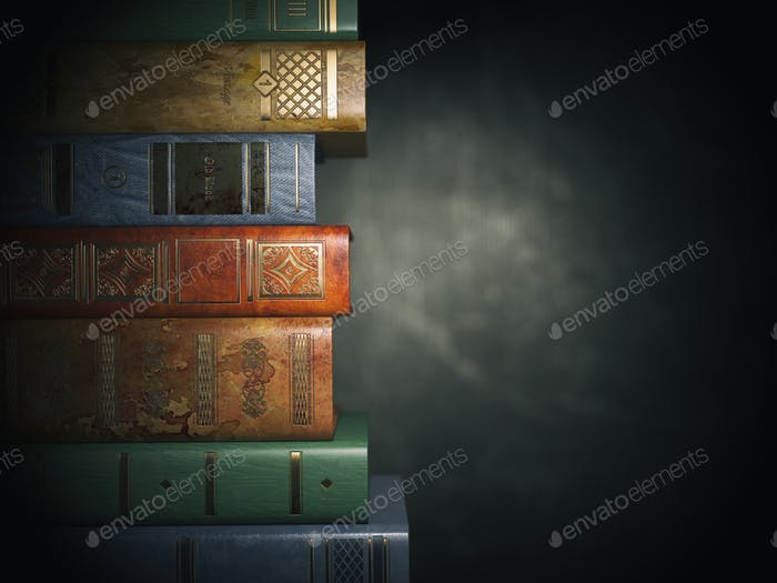 Vintage books on old  black dirty background.