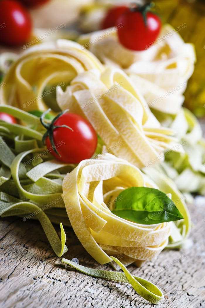 Dried pasta tagliatelle with basil and tomatoes