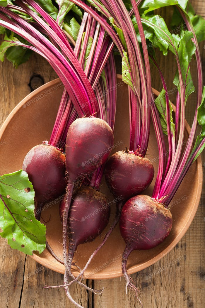 fresh beet in wooden bowl