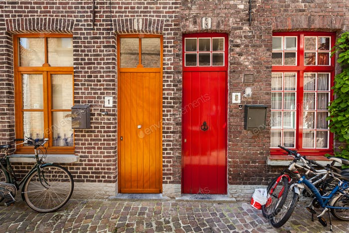 Doors of old houses and bicycles in european city Bruges (Brugge