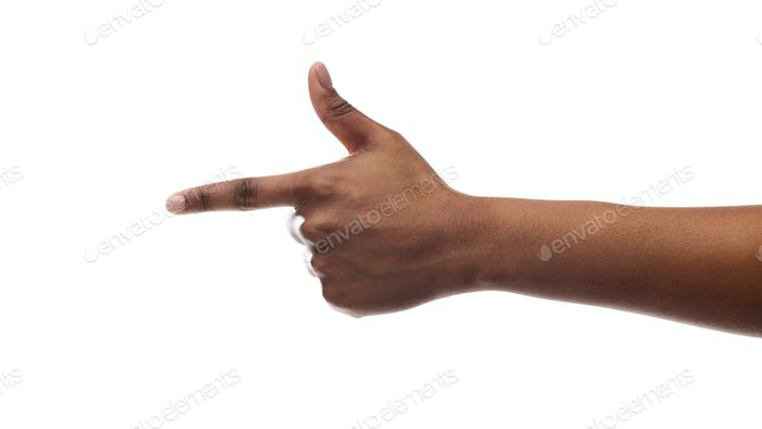 Black female hand pointing on virtual object with index finger