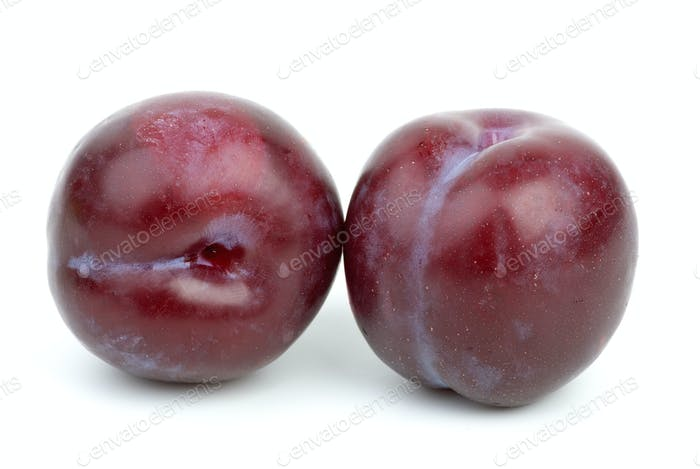 Two violet plums