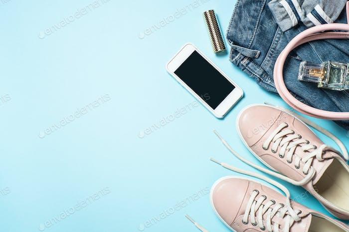 Woman fashion cloth set pink shoes, jeans, handbag, smartphone a
