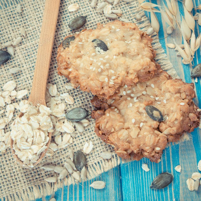 Vintage photo, Fresh baked oatmeal cookies with ingredients for baking