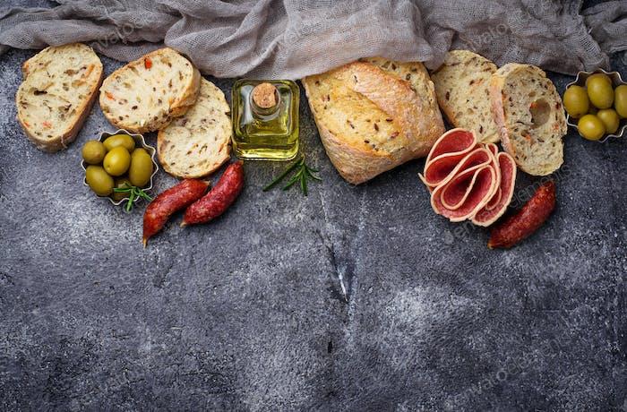 Italian ciabatta bread with olives and salami.