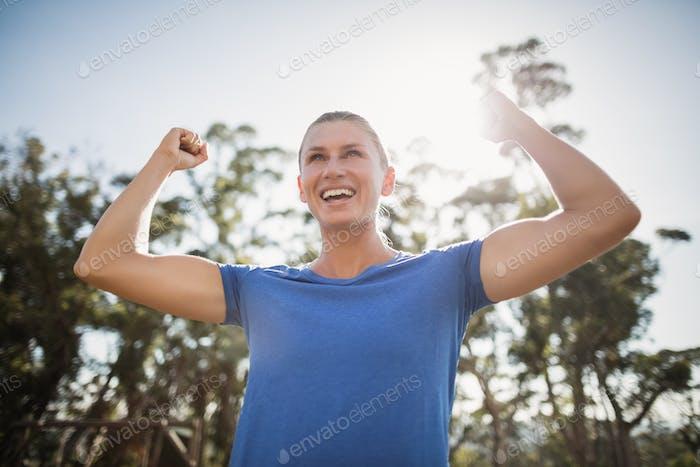Fit woman cheering in joy