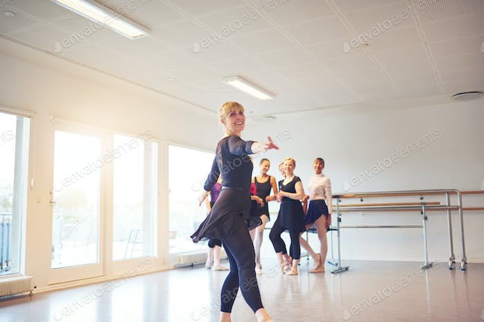 Mature woman practicing ballet in a dance studio