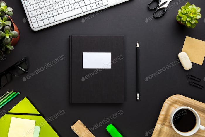 Folder With Label Surrounded By Office Equipment On Gray Desk