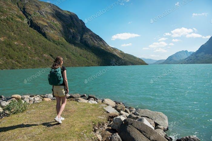 traveler looking at Gjende lake in Jotunheimen National Park, Norway