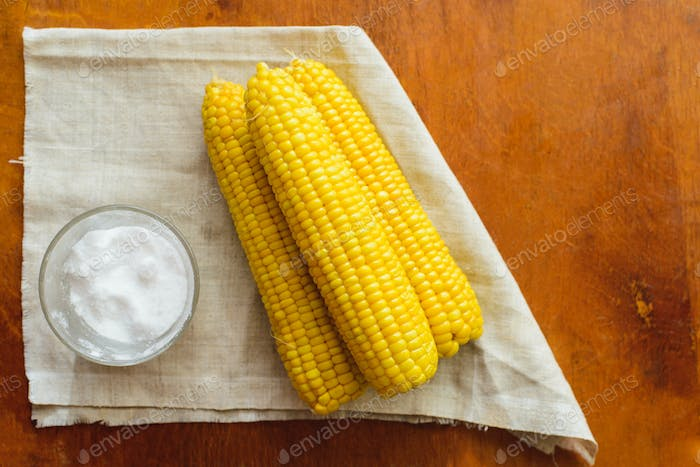 rustic concept just cooked corn with salt on table