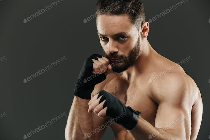 Portrait of a confident muscular boxer ready to fight