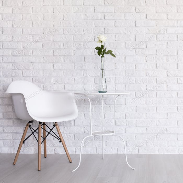 White simple room with modern chair