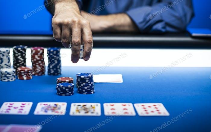 Winning man betting chips at casino