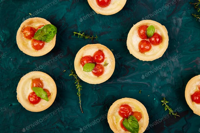 Mini tarts with cherry tomatoes