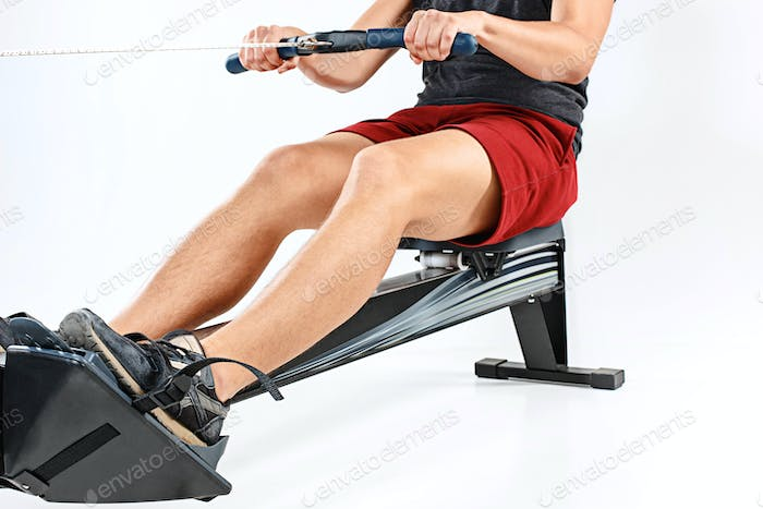 Man Using A Press Machine In A Fitness Club.