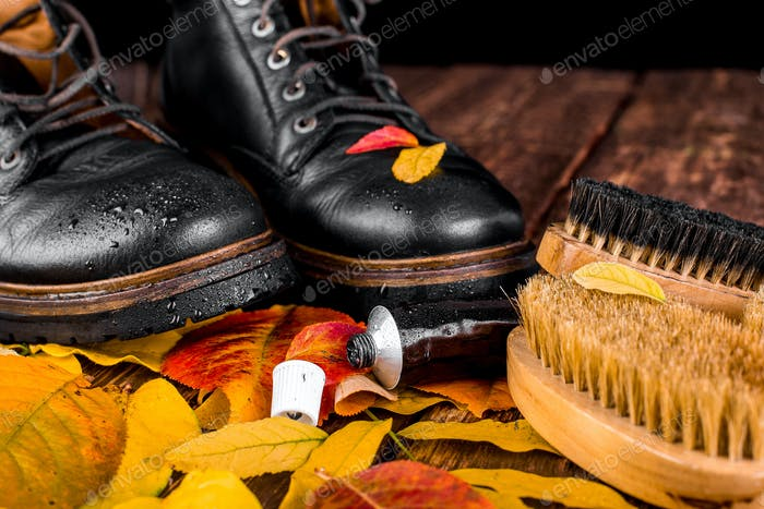 Black boots on wooden background