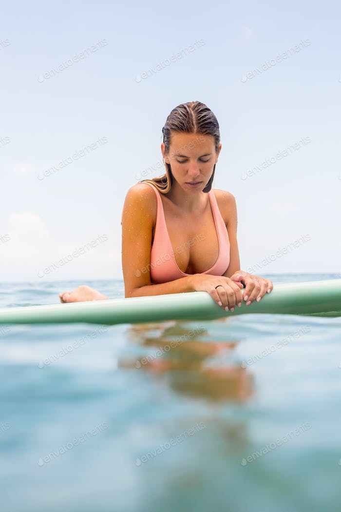Sexy surfer girl with longboard surf.