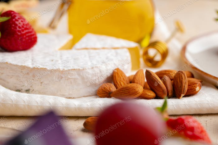 Cheese with nuts and strawberry close up