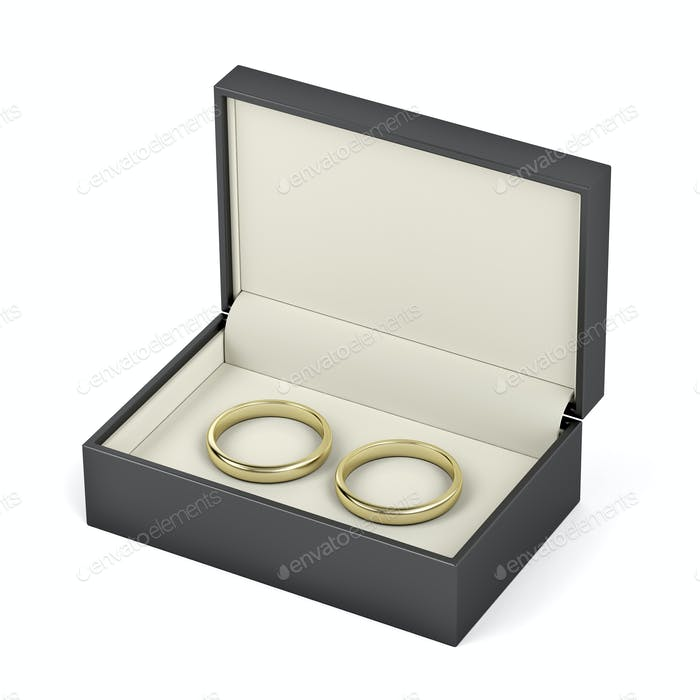 Box with gold wedding rings