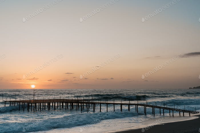 Pier on the sea in the sunrise