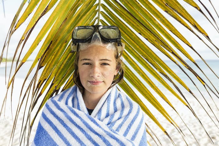 13 year old girl in front of palm fronds