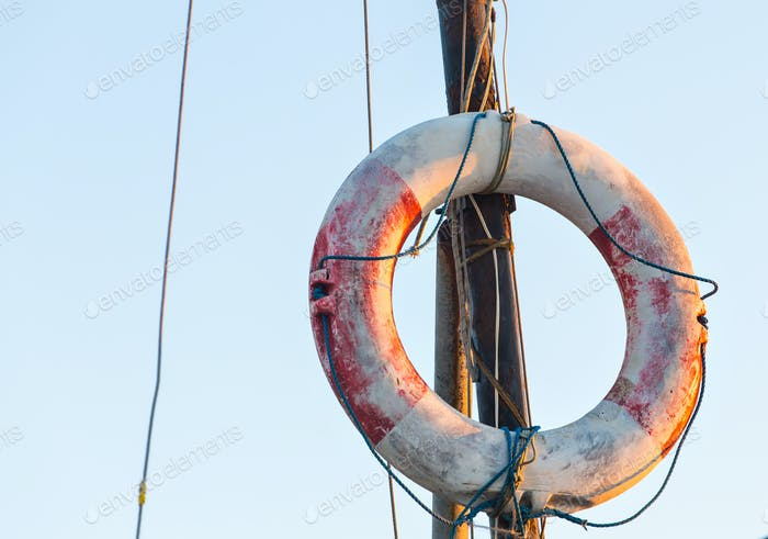 Orange Lifebuoy in front of the blue sky