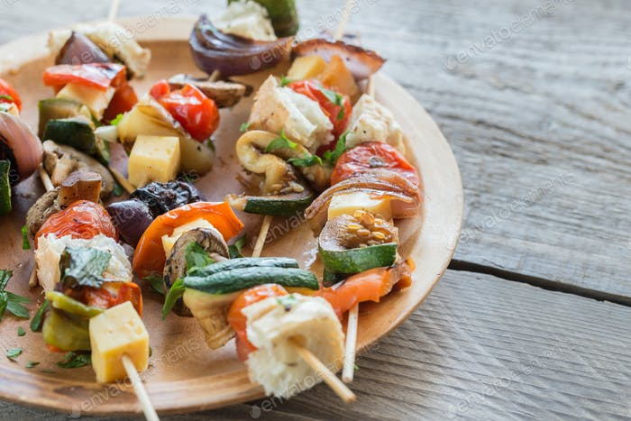 Grilled vegetable skewers on the plate