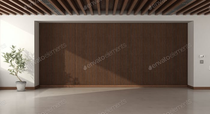 Empty room with wooden paneling and roof beams
