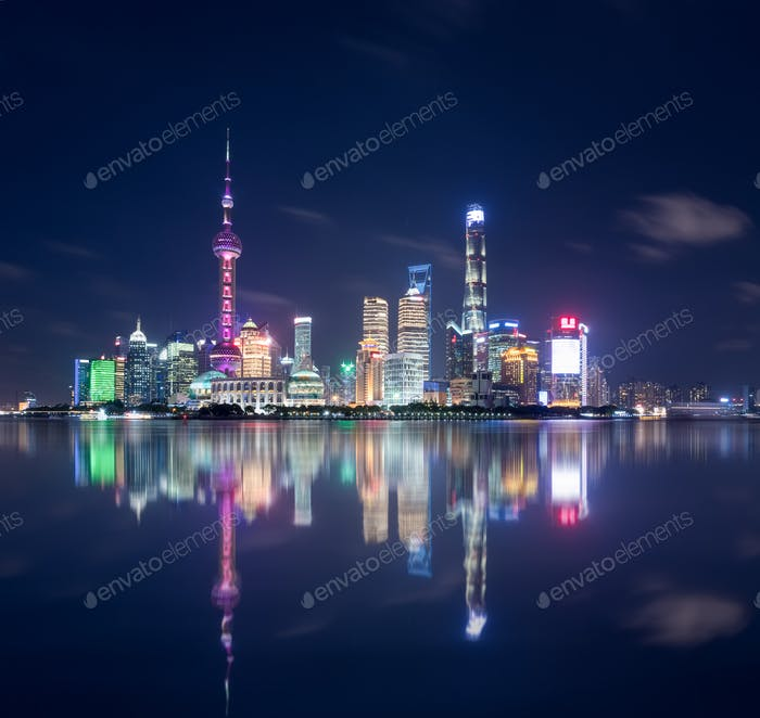 beautiful shanghai skyline and reflections,  abstract cityscape at night