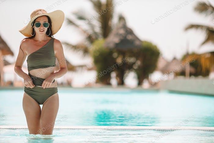 Beautiful woman at luxury resort near pool