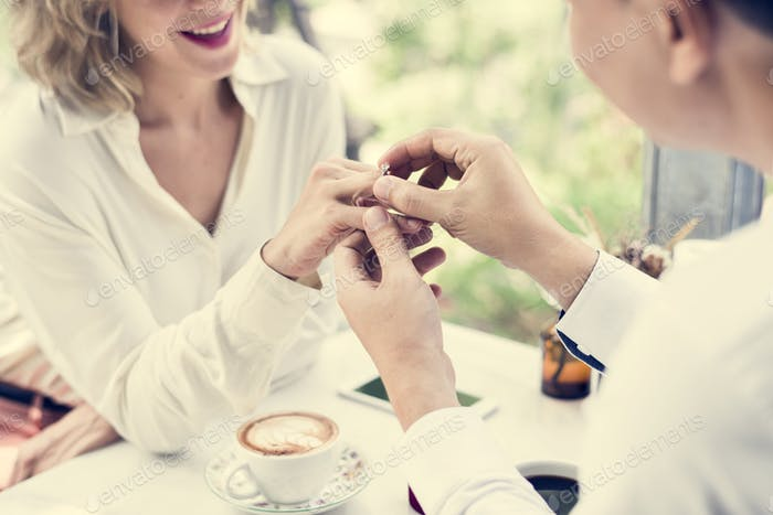 Man proposing girlfriend with diamond ring